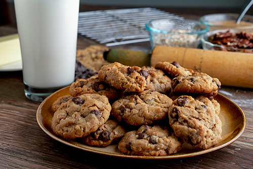 plate of cookies with glass of milk