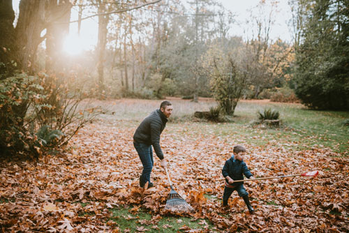 dad-and-son-raking-leaves