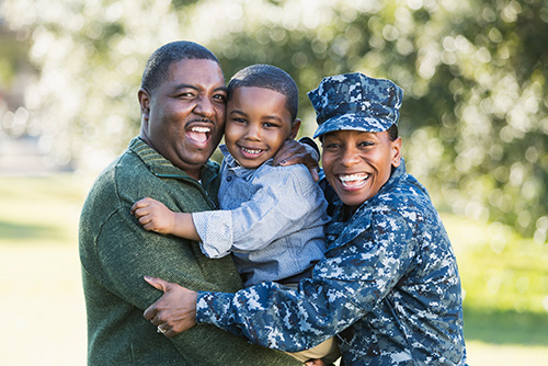 African American Military woman with her spouse and child